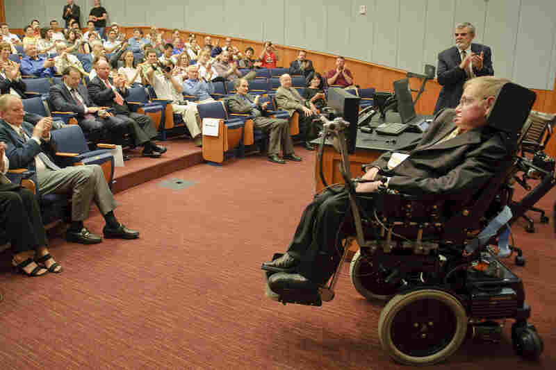 Hawking receives applause from the crowd after commenting during the dedication of an auditorium named after him at the George P. and Cynthia Woods Mitchell Institute for Fundamental Physics and Astronomy on the Texas A&M campus on April 5, 2010.
