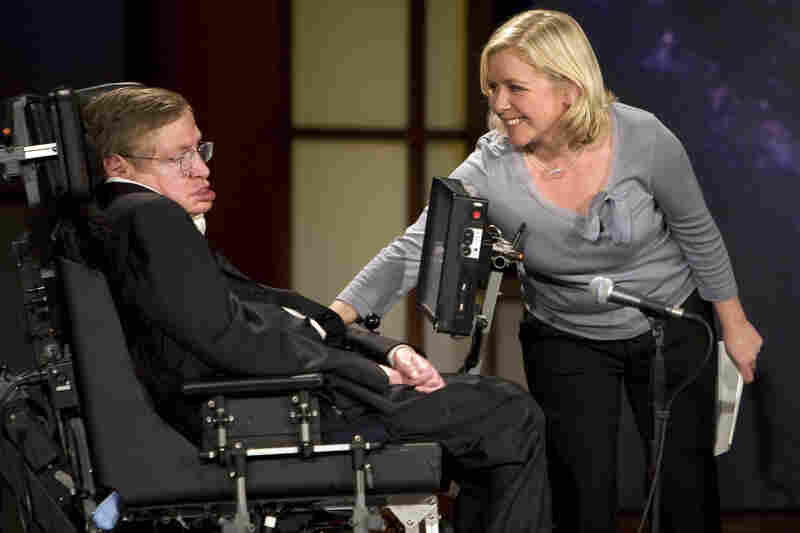 "Lucy Hawkings (right) touches her father Stephen Hawking (left) as they give a lecture entitled ""Why We Should Go Into Space"" during the 2008 ""50 Years of NASA"" lecture series at George Washington University in Washington, DC."