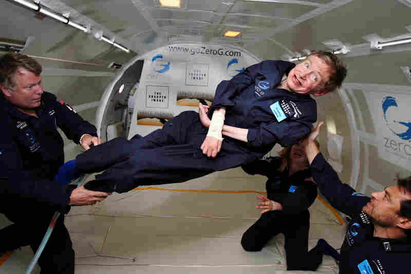 In this handout photo provided by Zero Gravity Corp., Hawking floats on a zero-gravity jet on April 26, 2007. The modified jet carrying Hawking, a handful of his physicians and nurses and dozens of others first flew up to 24,000 feet over the Atlantic Ocean off Florida and then dove down, allowing the passengers to experience zero gravity.