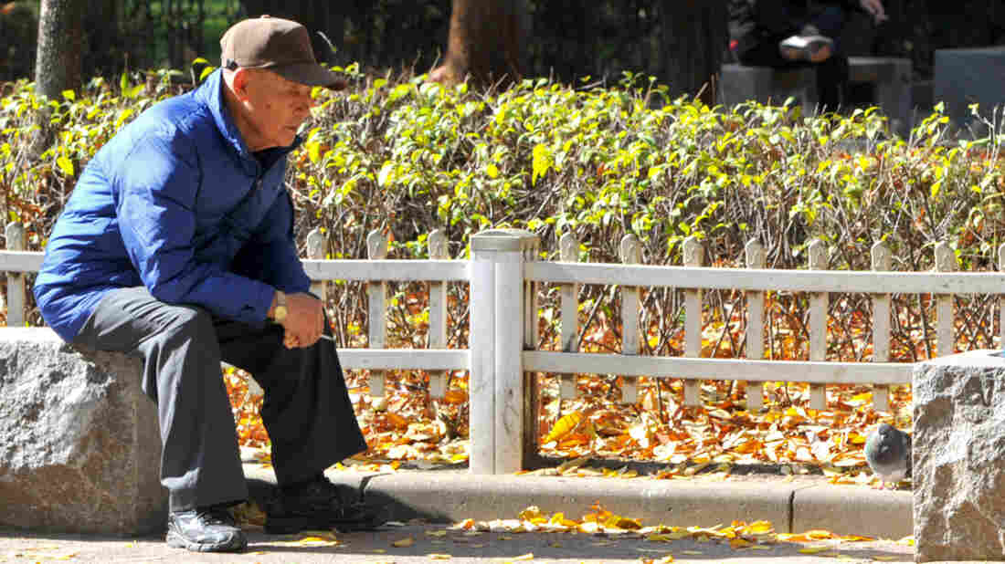 A man relaxes at a downtown park in Seoul. The pronounced demographic shift triggered by a plummeting birth rate and soaring life expectancy is seen as one of the grea