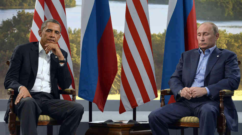President Obama meets with Russian President Vladimir Putin in Northern Ireland on June 17. A new Gallup poll says Americans are increasingly viewing both Putin and Russia less fa