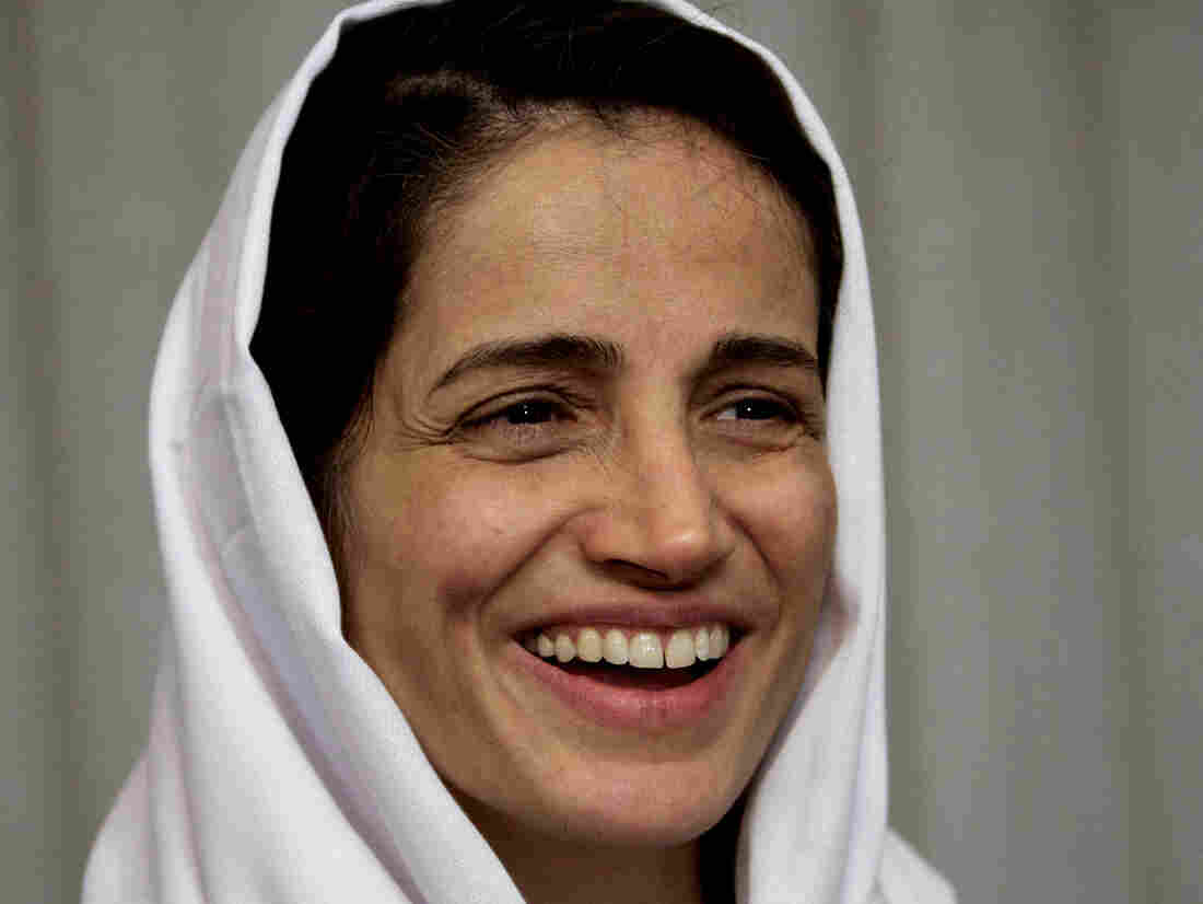 Iranian lawyer Nasrin Sotoudeh smiles at her house in Tehran on Wednesday, after being freed from prison.