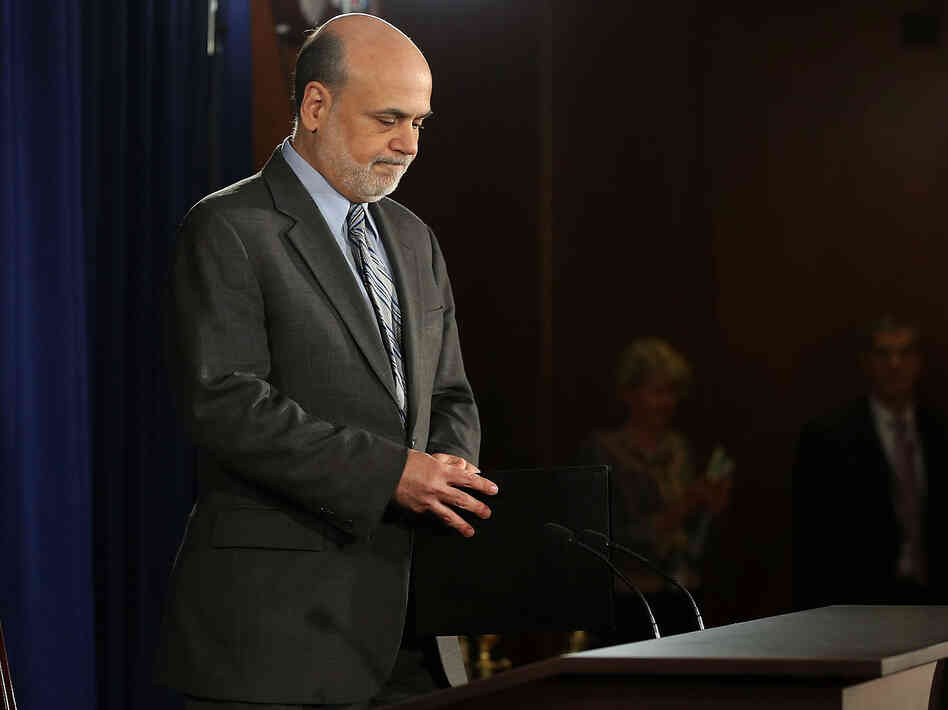 Federal Reserve Chairman Ben Bernanke arrives to speak at a news conference Wednesday in Washington, D.C. The Fed cut its economic growth