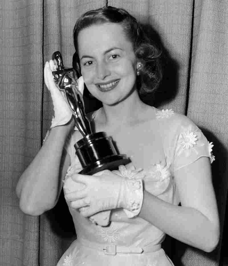 De Havilland holds her second Oscar for best actress, which she won for her role in The Heiress.
