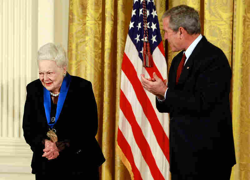 President George W. Bush congratulates de Havilland after presenting her with the 2008 National Medal of Arts during an event at the White House.