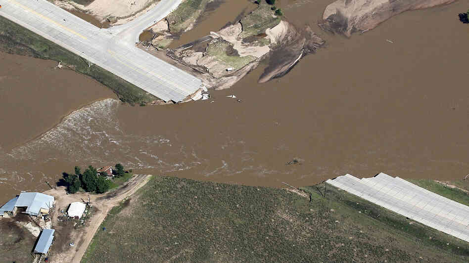 A view from the air Tuesday of one of the roads that have been cut by floodwaters in Weld County, Colo.