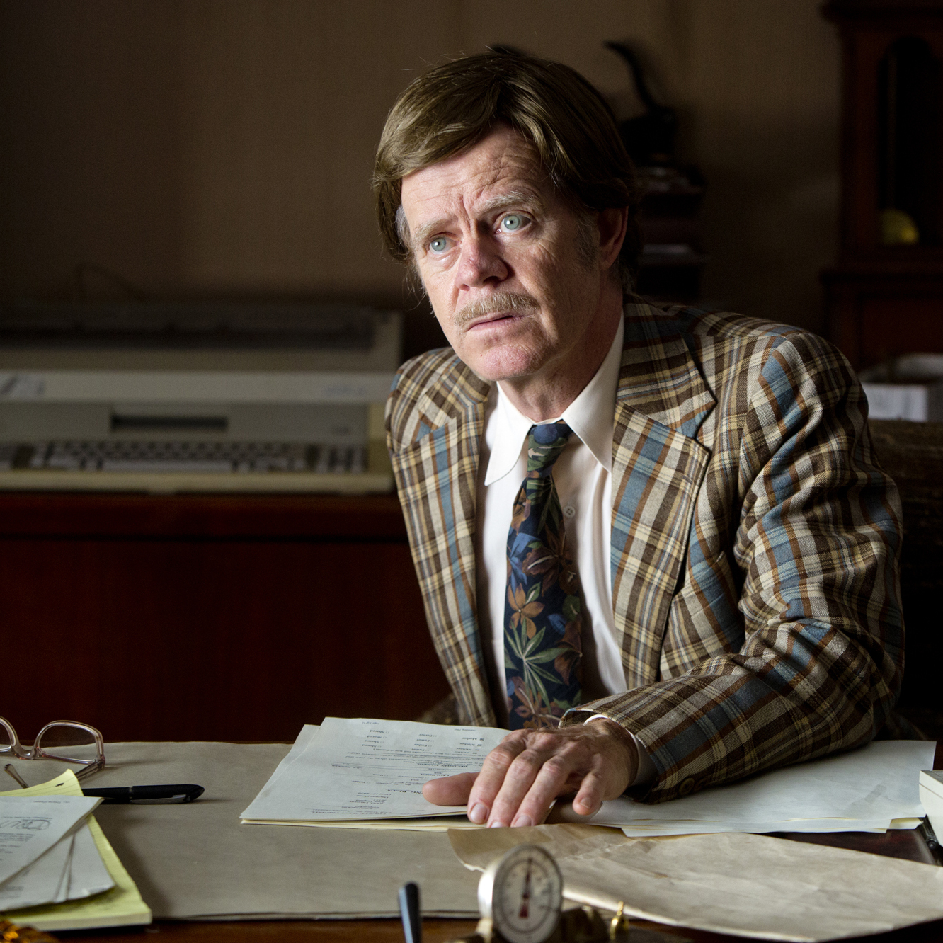 In the more compelling but less complete of the film's two story lines, John's low-rent lawyer (William H. Macy) is helping him fight his wife's divorce action.