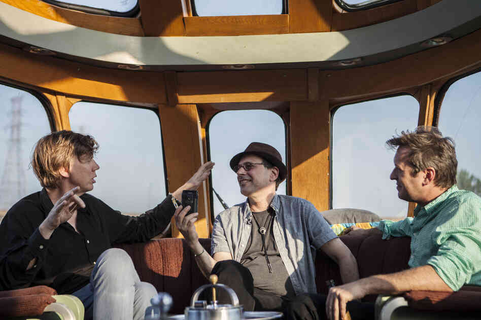 From left: Sonic Youth's Thurston Moore, All Songs Considered host Bob Boilen and multimedia artist Doug Aitken aboard the Station To Station train.
