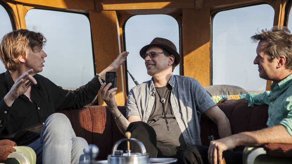 From left: Sonic Youth's Thurston Moore, All Songs Considered host Bob Boilen and multimedia artist Doug Aitken aboard the Station To Station train. (Mara McKevitt)