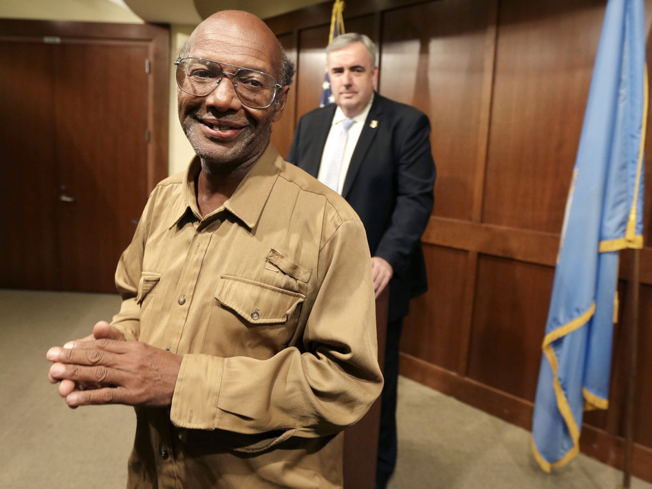 Glen James, a homeless man who found $42,000 and turned it in to police, after he was honored for his honesty earlier this week by Boston Police Commissioner Edward Davis (in background).