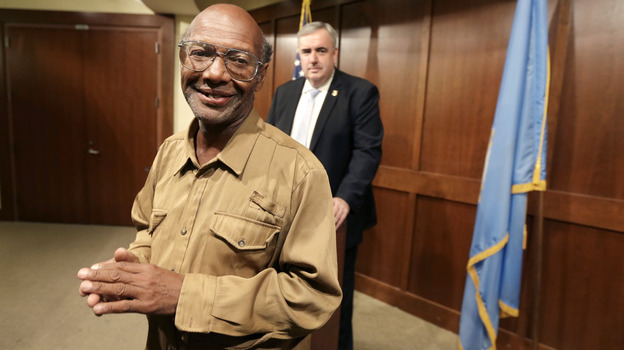 Glen James, a homeless man who found $42,000 and turned it in to police, after he was honored for his honesty earlier this week by Boston Police Commissioner Edward Davis (in background). (AP)