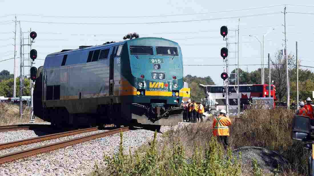 Officials monitor the scene of a crash between a passenger train en route to Toronto and a double-decker bus at a crossing in Ottawa, Ontario, Canada on Wednesday.