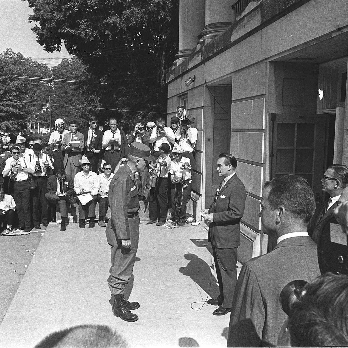 National Guard Brig. Gen. Henry Graham informs Alabama Gov. George Wallace that the guard was under federal control as the two met at the door of Foster Auditorium at the University of Alabama in Tuscaloosa on June 11, 1963. Wallace, who had vowed to prevent integration of the campus, gave way to federal troops.