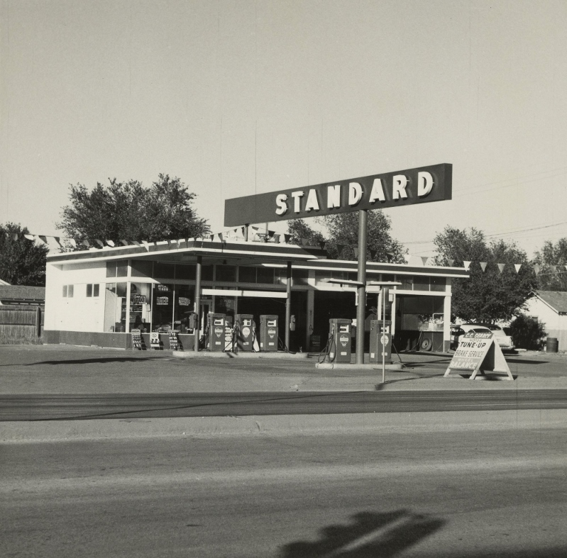 Ed Ruscha'��s first artist book Twentysix Gasoline Stations featured simple black-and-white snapshots of gas stations that he photographed along Route 66 on his road trips from Los Angeles to Oklahoma City. The book would go on to influence a generation of artists with its industrial style and casual look.