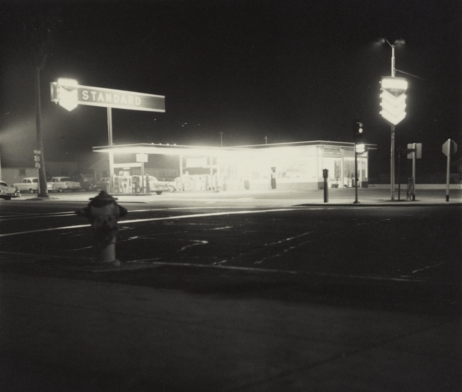 Another image from <em>Twentysix Gasoline Stations</em>: <em>œStandard, Figueroa Street, Los Angeles</em>, taken in 1962. The humble gas station also made an appearance in Ruscha's painted works.