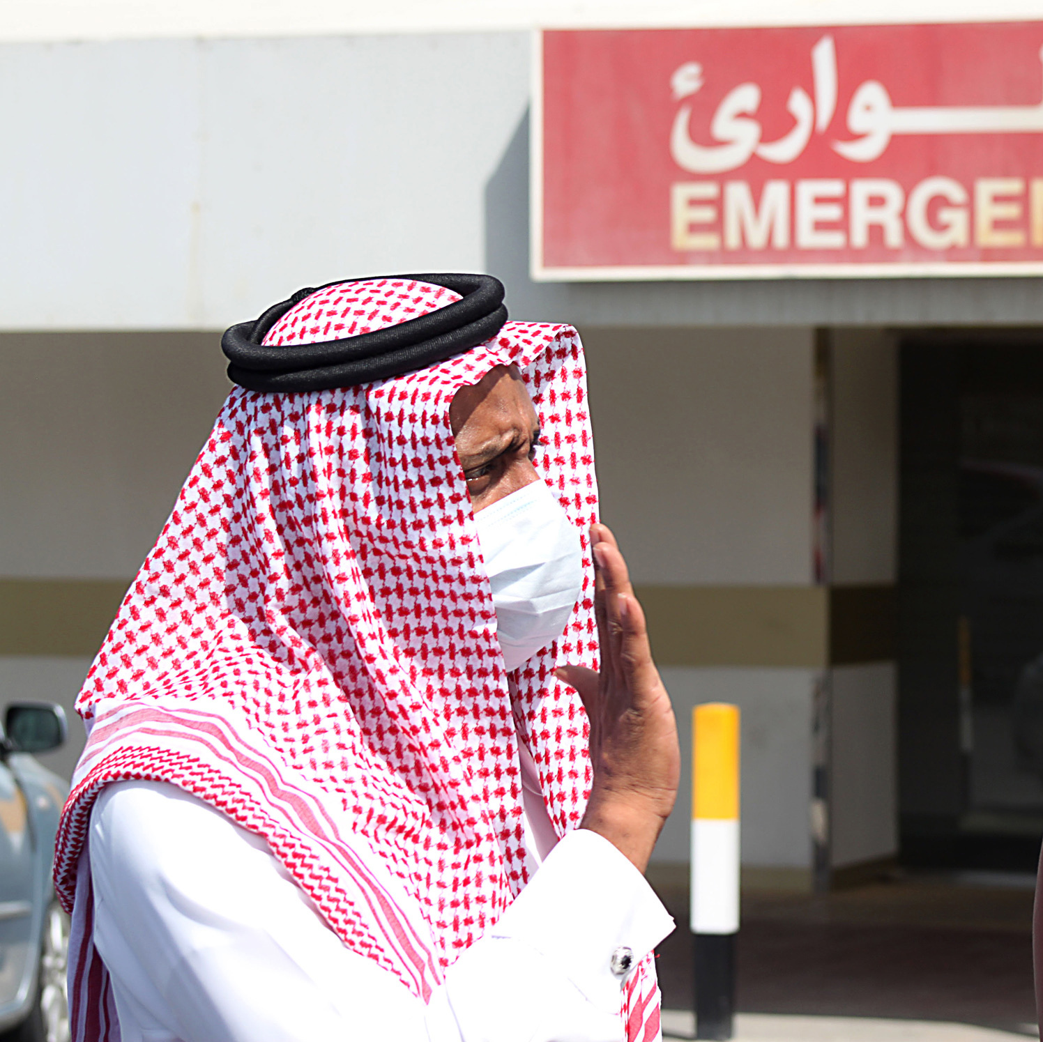 Men wear surgical masks to protect against the Middle East respiratory syndrome virus outside a hospital in Dammam, Saudi Arabia.