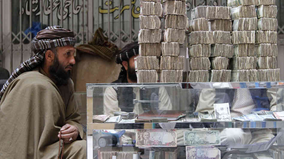 An Afghan dealer waits for customers at a money market in Kandahar province, in November 2012. The U.S. has started attacking the Taliban's funding channels ahead of withdrawing most of its forces from Afghanistan by 2014.