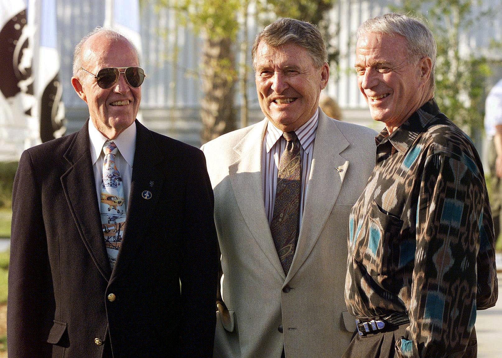 Mercury 7 astronauts Gordon Cooper (from left), Wally Schirra and Carpenter at a press conference at Kennedy Space Center in 1998. The three were in Florida to watch the launch of the Shuttle Discovery, which carried 77-year-old Glenn into orbit
