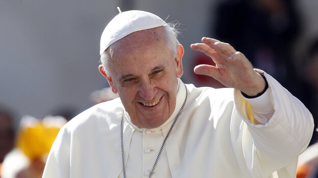 Pope Francis waves to faithful as he arrives for his weekly general audience in St. Peter's Square at the Vatican on Wednesday.