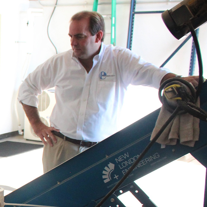 Glen Courtright, EnviroFlight's founder, is pictured with a machine that harvests the larvae, separating them from waste products.