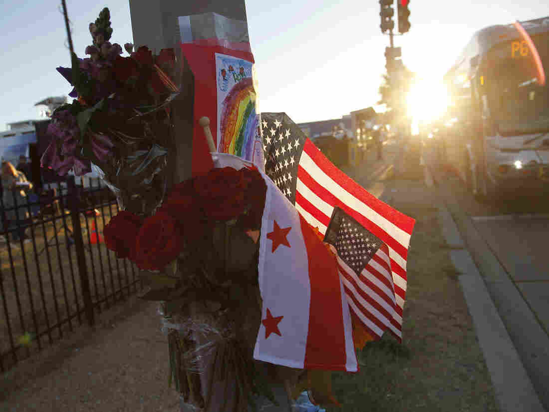 Flowers, flags and a child's drawing at a makeshift memorial outside the Washington Navy Yard, where a gunman killed 12 people on Monday.