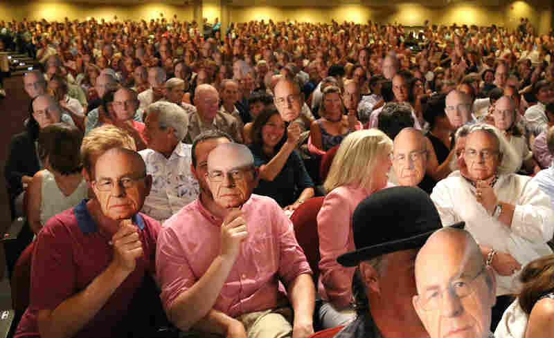 The audience at Wait Wait... Don't Tell Me! in Portland, Maine, holding up faces of Carl Kasell.