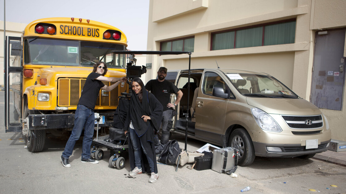 Women aren't permitted to travel unattended in the streets of Saudi Arabia, so Wadjda director Haifaa Al Mansour worked from inside a van, communicating with her crew via walkie-talkie.