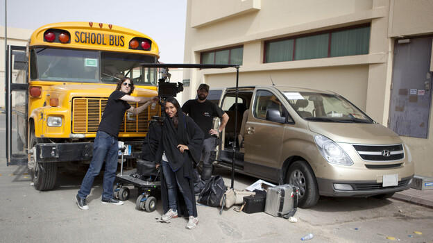 Women aren't permitted to travel unattended in the streets of Saudi Arabia, so Wadjda director Haifaa Al Mansour worked from inside a van, communicating with her crew via walkie-talkie. (Razor Film/Sony Pictures Classics)