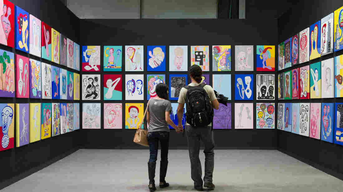 A couple review the work of Brazilian artist Victor Arruda during ArtRio, the International Art Fair of Rio de Janeiro, Brazil, on Sept. 5.