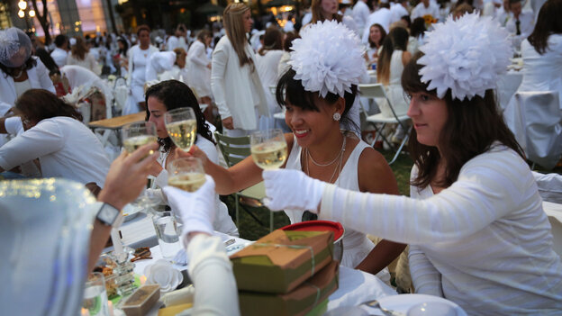 "At Diner en Blanc (""Dinner in White""), people arrive dressed all in white. They"