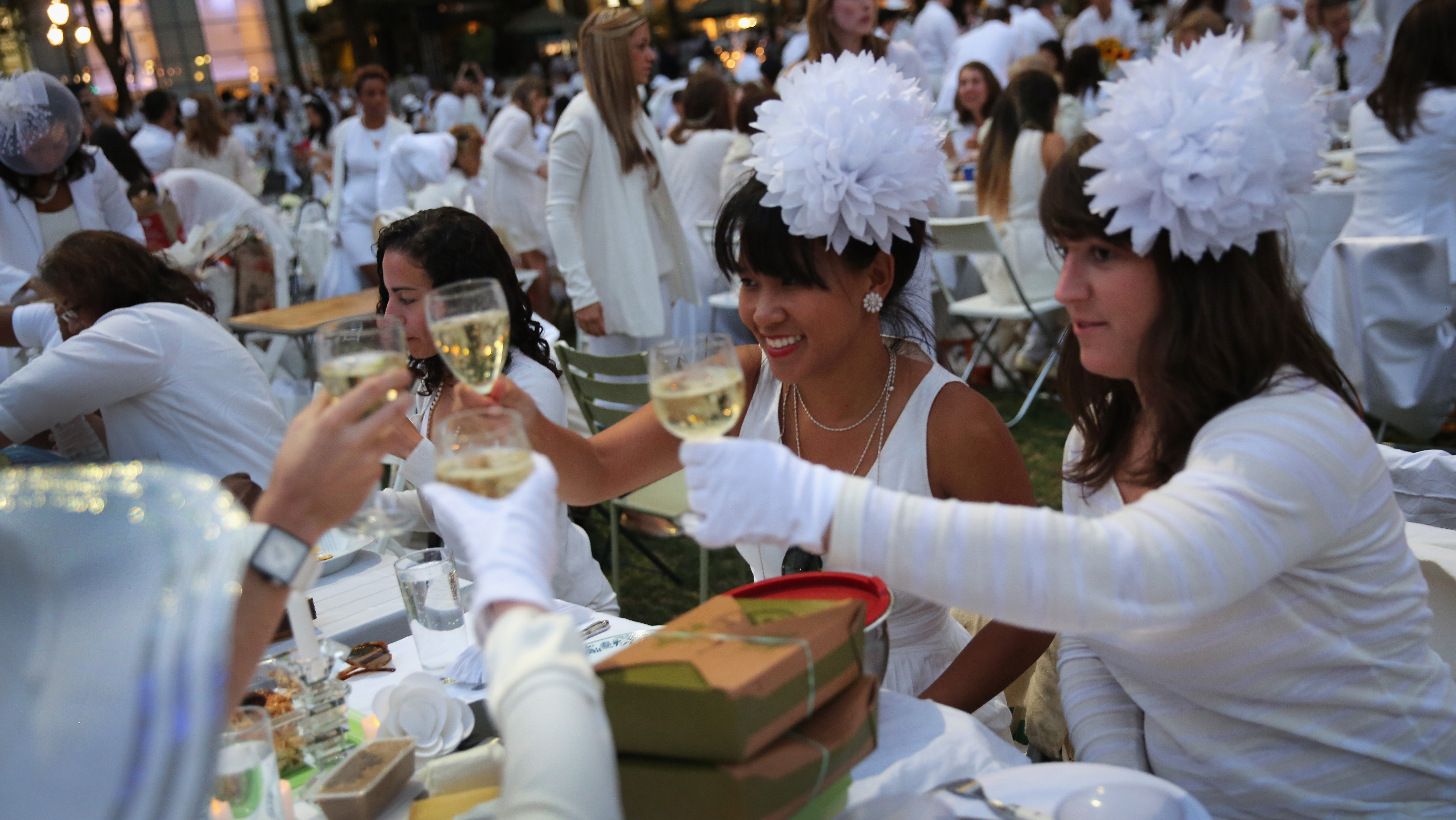 "At Diner en Blanc (""Dinner in White""), people arrive dressed all in white. They bring their own food and, fittingly,� white wine."
