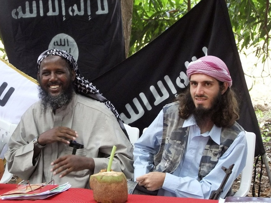 In this 2011 photo, American-born Islamist militant Omar Hammami, right, sits with al-Shabab deputy leader Sheikh Mukhtar Abu Mansur Robow during a press conference in Somalia.