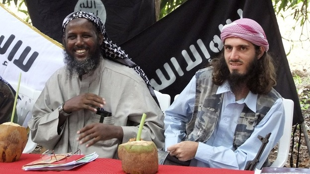 In this 2011 photo, American-born Islamist militant Omar Hammami, right, sits with al-Shabab deputy leader Sheikh Mukhtar Abu Mansur Robow during a press conference in Somalia. (AP)