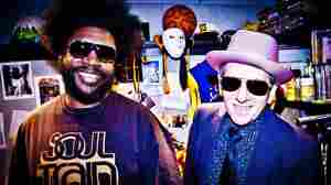 ?uestlove and The Roots play backing band to Elvis Costello on the new collaborative album Wise Up Ghost.