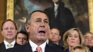House Speaker John Boehner, R-Ohio, speaks at a Republican rally Friday after the House passed a measure that would temporarily fund the government while crippling President Obama's health care law. The Senate is not expected to follow suit.