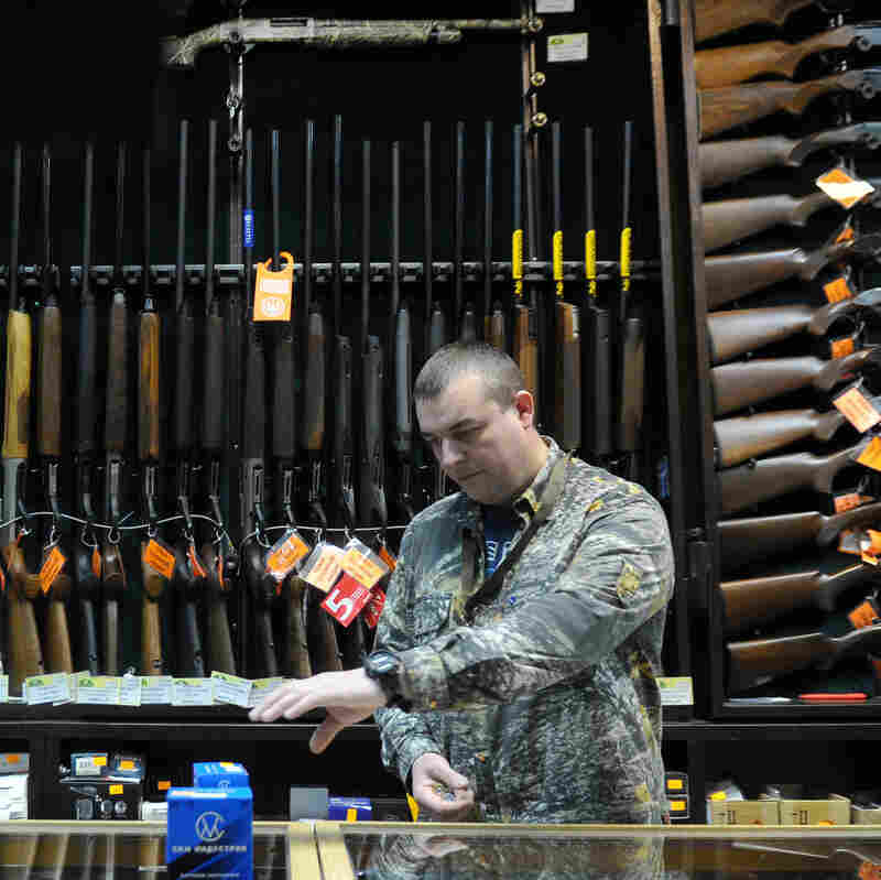 A worker at the Grand Okhota sportsman gun shop in Moscow on April 23.
