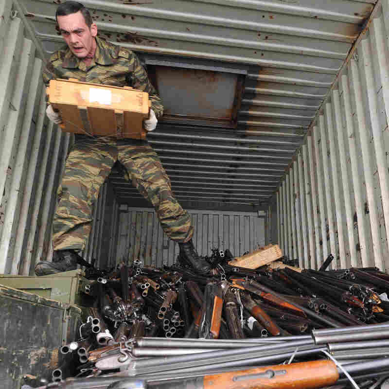 A Russian police officer unloads guns seized from the public that are to be melted down in the Rostov-On-Don region on May 28. Russia has strict gun laws and far fewer guns in circulation than the U.S., but Russia has a much higher murder rate.
