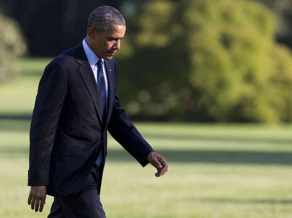 President Obama arrives on the South Lawn of the White House on Friday.