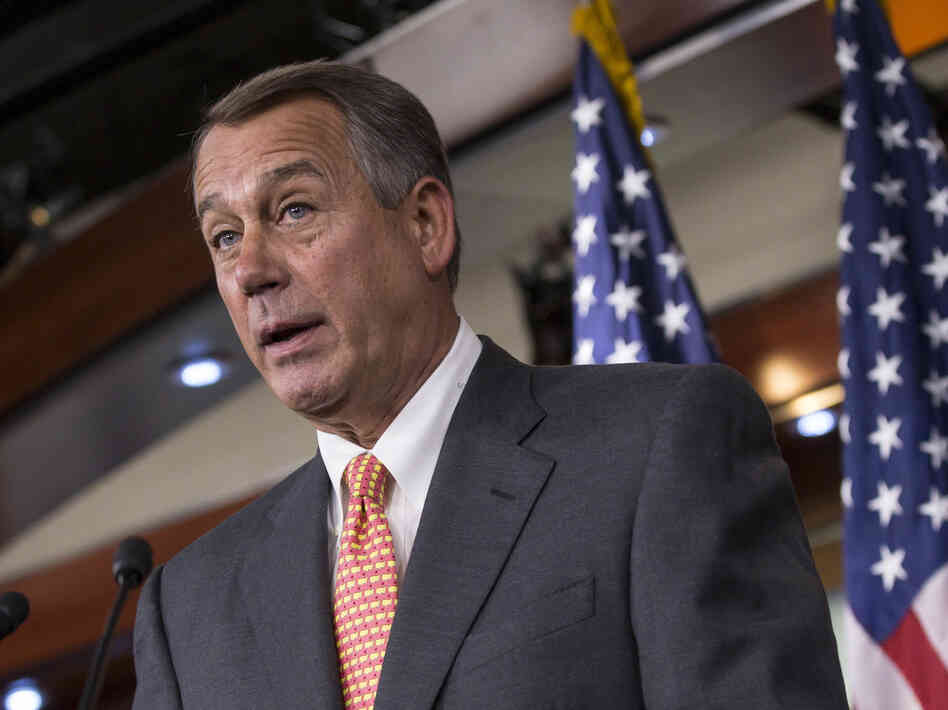 Speaker of the House John Boehner (R-Ohio) talks to reporters Thursday about the deadline to fund the government