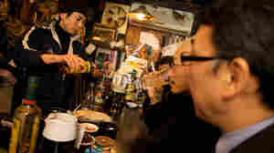 A Japanese micro-bar only has room for four customers at a time.