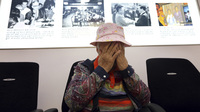 South Korean Cho Jang-geum, 81, weeps as she fills out an application to reunite with family members who live in North Korea, at the headquarters of the Korean Red Cross in Seoul Saturday. North Korea announced today that it is indefinitely postponing the reunions of families who were separated by the 1950-53 Korean War. The meetings were to take place in the coming week.