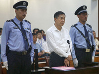 Disgraced politician Bo Xilai stands during his trial on corruption charges in August.