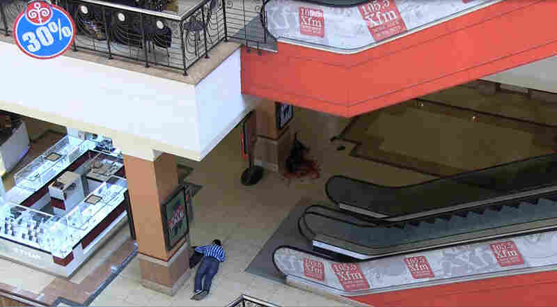 The bodies of victims lay on the shopping center floor on Saturday. The rebels said the attack was retribution for Kenyan forces' 2011 push into Somalia. Kenyans and foreigners were among those confirmed dead, including French, Canadians and Chinese.