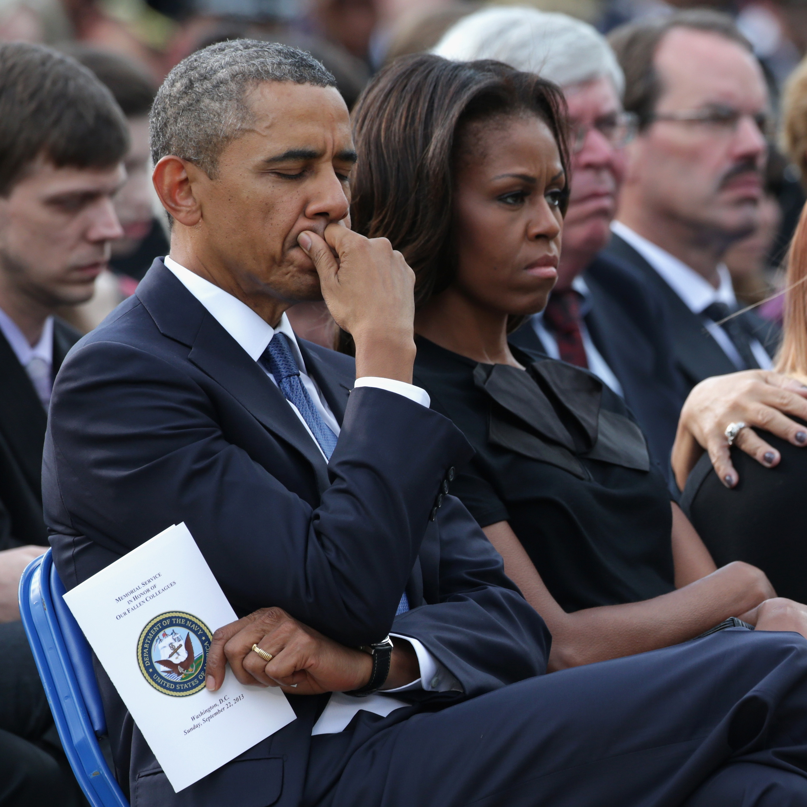 President Barack Obama and first lady Michelle Obama attend a memorial for victims of the Navy Yard shooting at the Marine barracks in Washington, D.C., on Sunday.