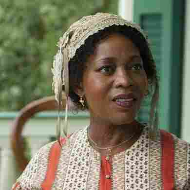 Alfre Woodard as Mistress Harriet Shaw and Lupita Nyong'o as Patsey in 12 Years a Slave.