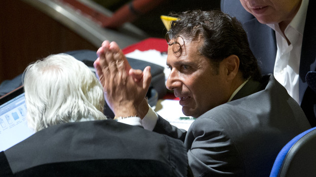 Captain Francesco Schettino talks to his lawyer during a pause his trial, in Grosseto, Italy, on Monday. (AP)