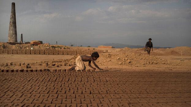 Near Islamabad, Pakistan, 6-year-old Jabro Mounir was arranging bricks this summer — part of his