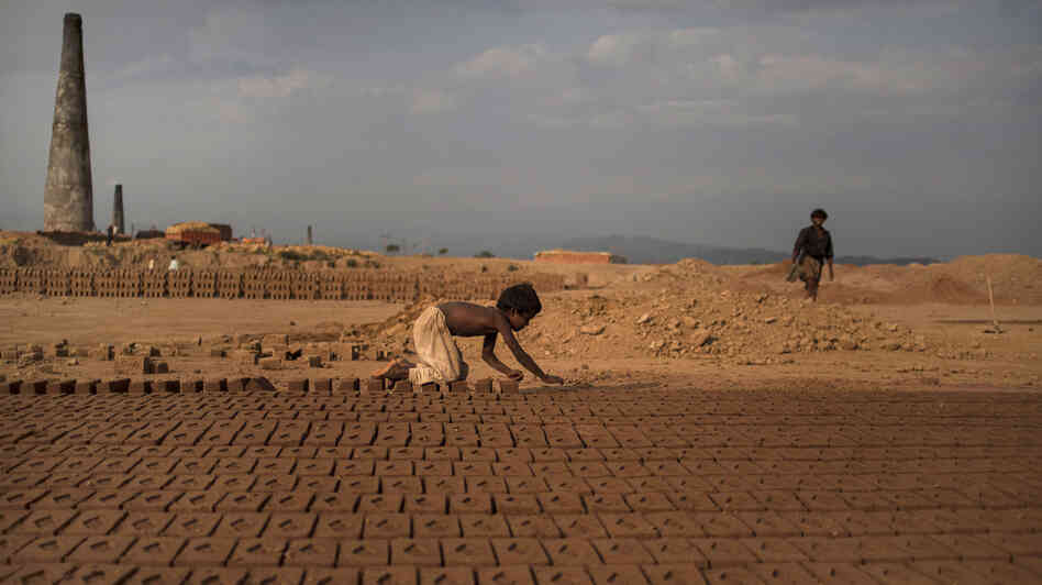 Near Islamabad, Pakistan, 6-year-old Jabro Mounir was arranging bricks this summer — part of his daily work at a b