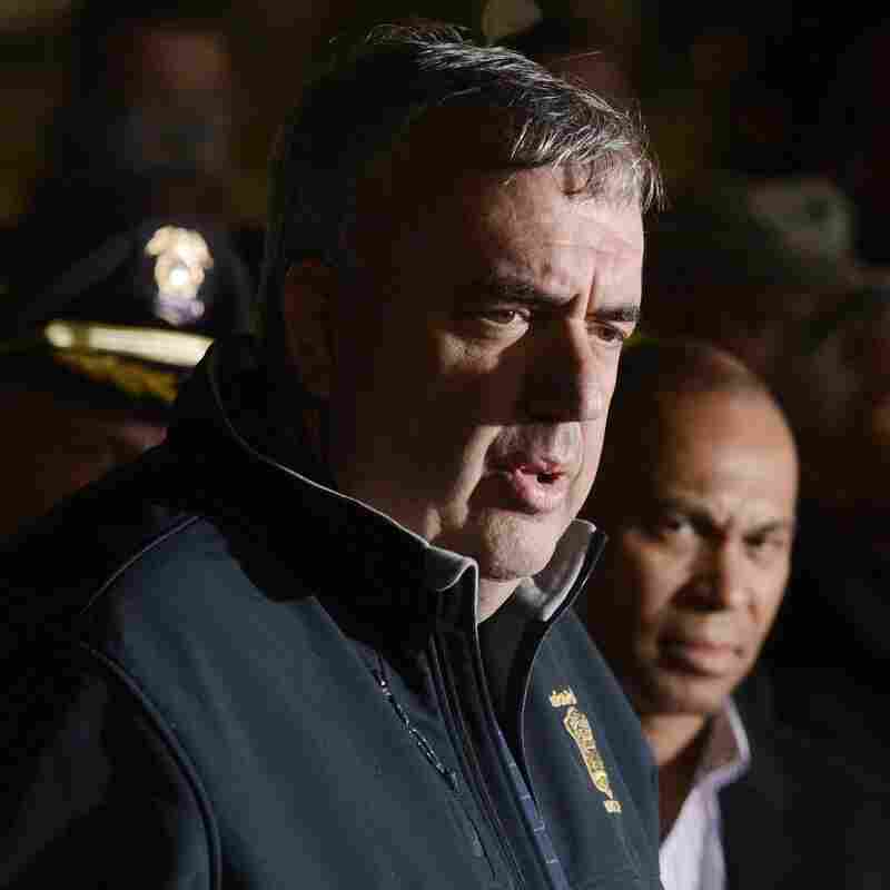Boston Police Commissioner Edward Davis talks with reporters during the hunt for the Boston Marathon bombers in April.