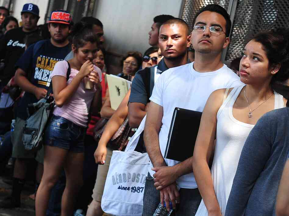 Young people stand in line in Los Angeles to apply for the Deferred Action for Childhood Arrivals program, which allows qualified immigrant